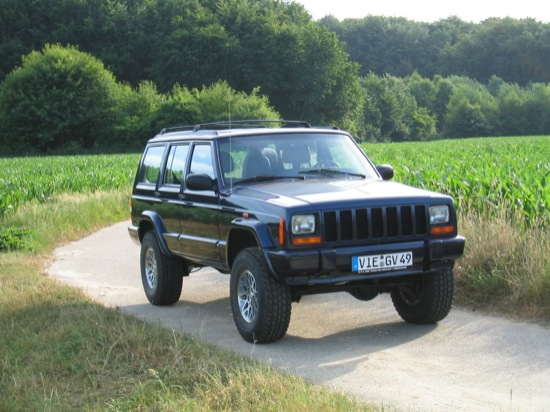 Blue 1997 Jeep Cherokee On Country Road